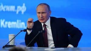 普京14日召开年度记者会 陪跑女对手列位记者席